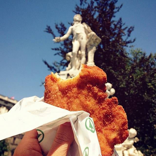 girl-eat-world-schnitzel-vienna
