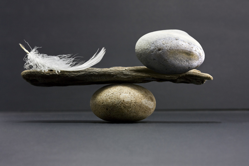 a feather and a stone equally balance