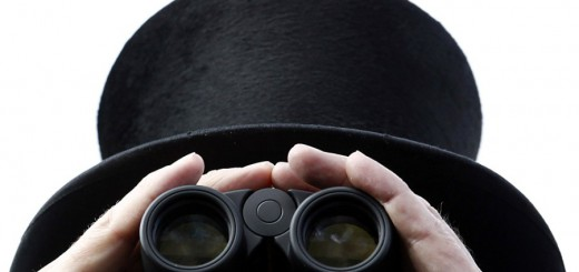 A racegoer uses his binoculars on the first day of racing at Royal Ascot in southern England