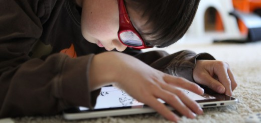 Child-using-an-iPad-tablet