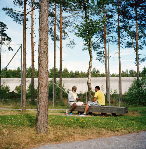 Halden Prison, Norway, June 2014: Inmates playing cards. -- No Commercial use -- Photo: Knut Egil Wang/Moment/INSTITUTE
