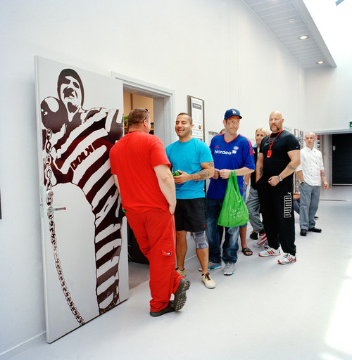 Halden Prison, Norway, June 2014: Inmates in line to shop for food in the prison grocery store. -- No commercial use -- Photo: Knut Egil Wang/Moment/INSTITUTE