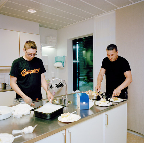 Halden Prison, Norway, June 2014: Inmates named Reijo (left) and Yassin with cake that Yassin made for another inmate's birthday. The cake is called Kvæfjord kake, a favorite confection of spongecake, custard, and meringue topped with almonds and whipped cream known to Norwegians as the ?World?s Best [Cake].? -- No commercial use -- Photo: Knut Egil Wang/Moment/INSTITUTE