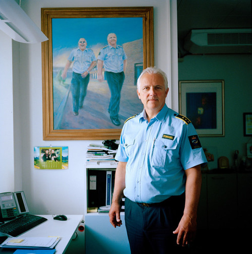 Halden Prison, Norway, June 2014: The Governor of Halden Prison, Are Høidal, in his office. The painting is made by a prisoner and shows Are and his closest coworker Jan Strømnes. -- No commercial use -- Photo: Knut Egil Wang/Moment/INSTITUTE