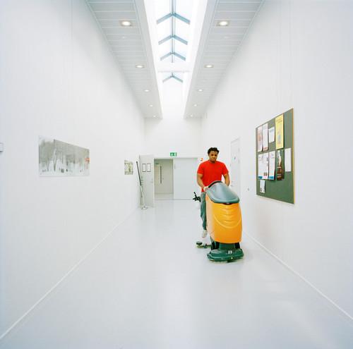 Halden Prison, Norway, June 2014: Prisoner cleaning the floors of a hallway inside Halden Prison. -- No commercial use -- Photo: Knut Egil Wang/Moment/INSTITUTE