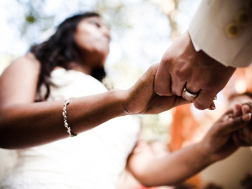 556702-hands-ceremony-ring-bride-76206-499x374