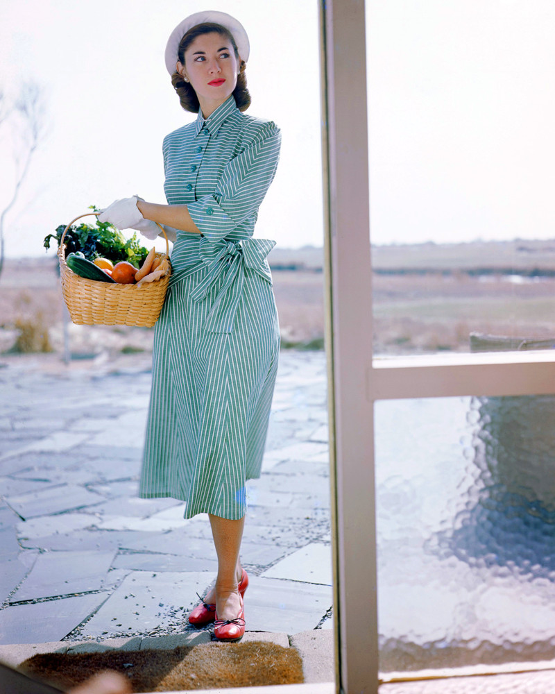 1949, Long Island, New York State, USA --- Janet Stevenson models a striped dress designed by Joset Walker and a hat designed by Sally Victor. --- Image by © Genevieve Naylor/Corbis