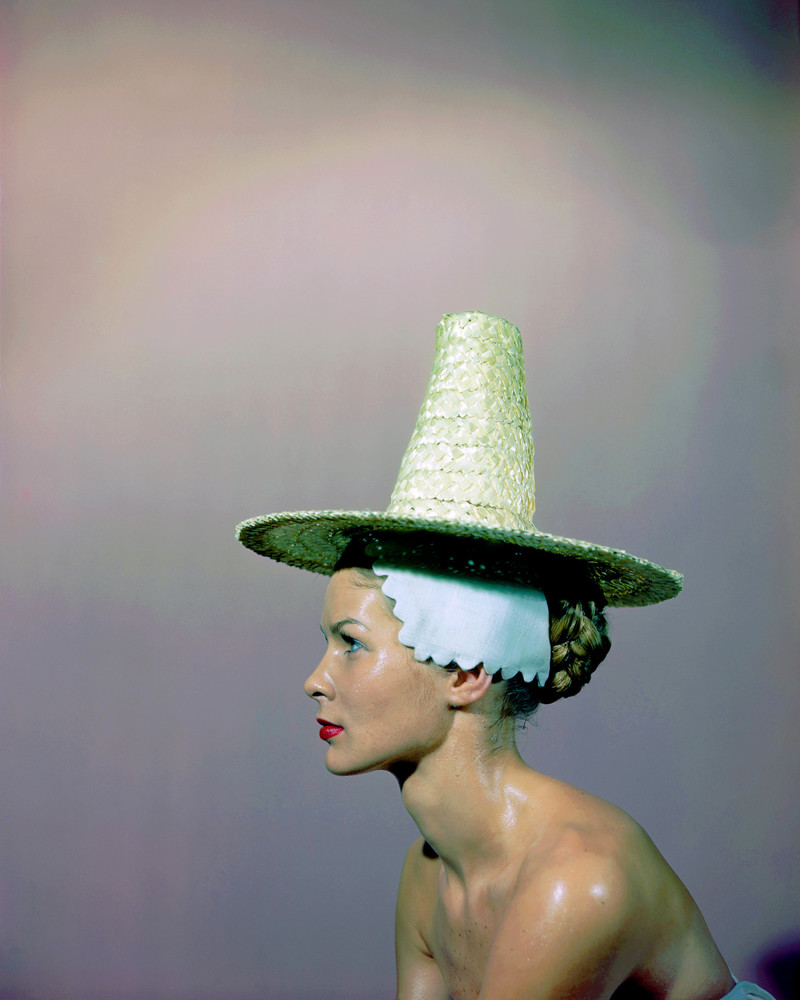Woman Modeling Straw Sun Hat