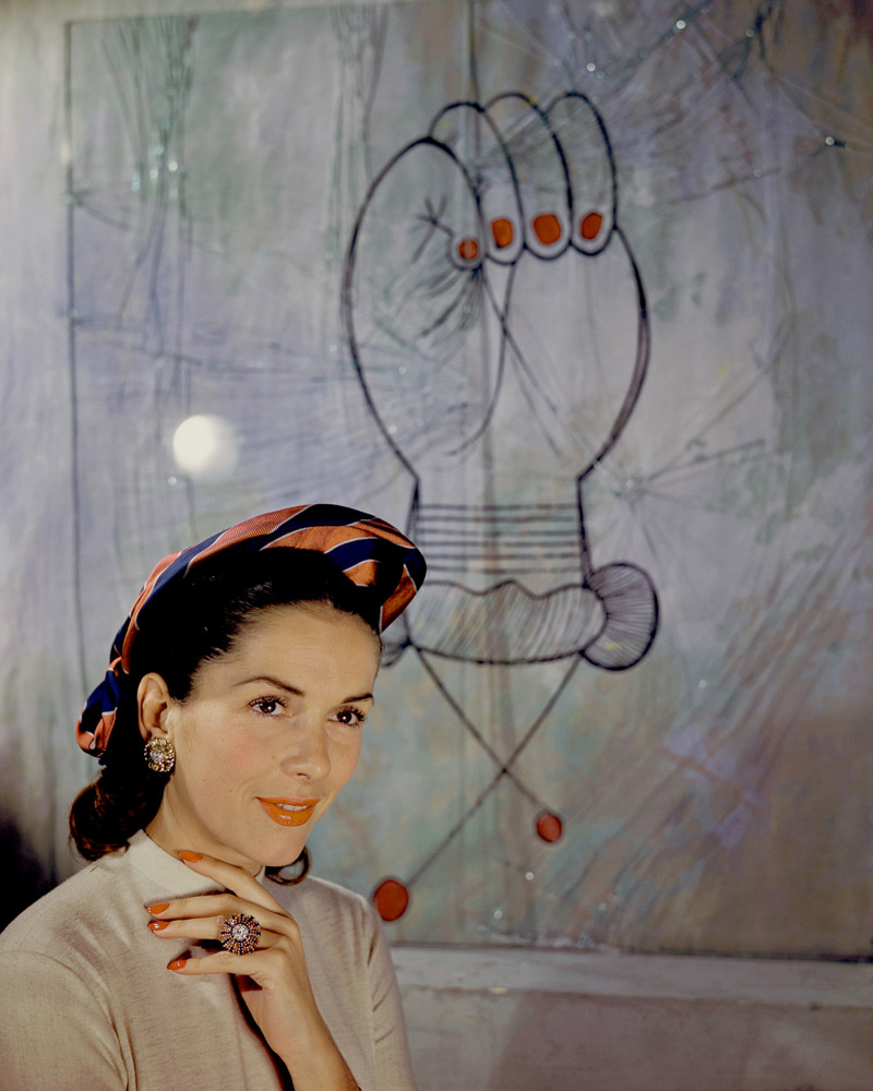 1946 --- Model Jinx Faulkenburg wears a hat by Suzanne Talbot next to a Picasso print. --- Image by © Genevieve Naylor/Corbis