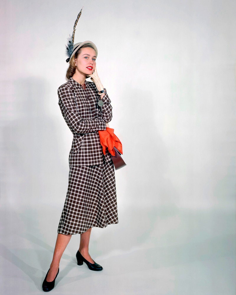 1950 --- Modeling a Plaid Day Dress --- Image by © Genevieve Naylor/Corbis