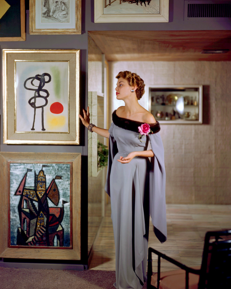 1950 --- Jean Pachett models a dress by Netti Rosenstein in the art-filled apartment of Raymond Loewy. --- Image by © Genevieve Naylor/Corbis