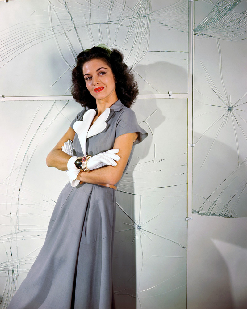 Carol Bruce Modeling a Gray Dress