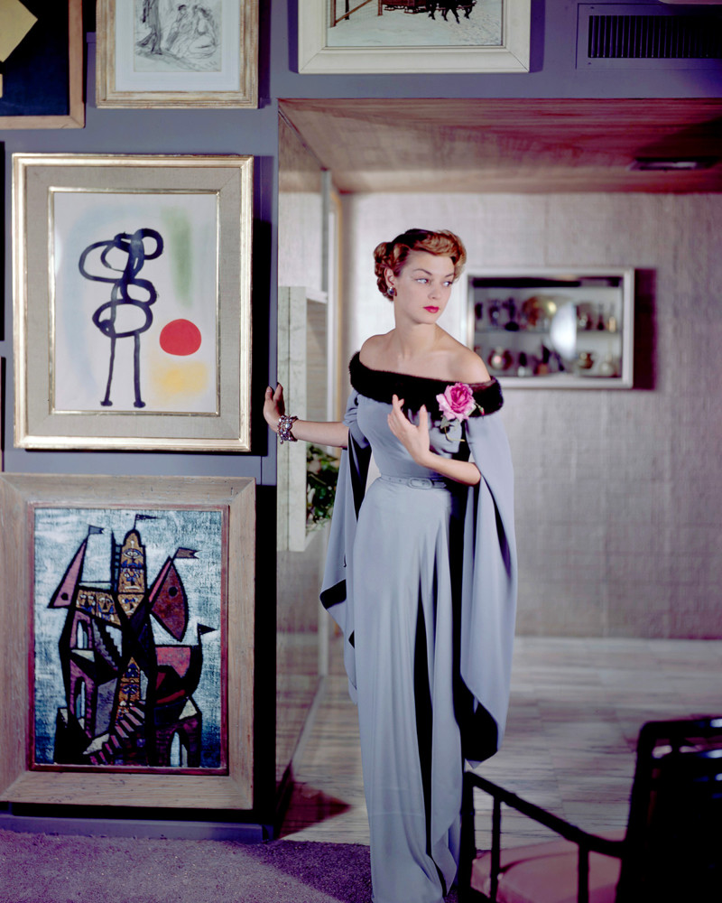1950 --- Jean Patchett models and evening dress designed by Netti Rosenstein at famous industrial designer Raymond Loewy's apartment. --- Image by © Genevieve Naylor/Corbis