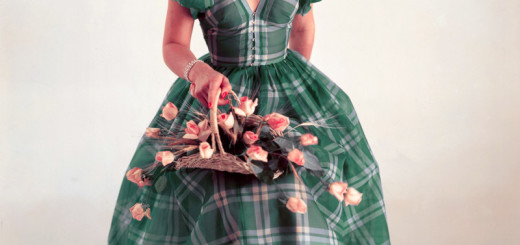 1954 --- A woman models a green plaid dress. --- Image by © Genevieve Naylor/Corbis