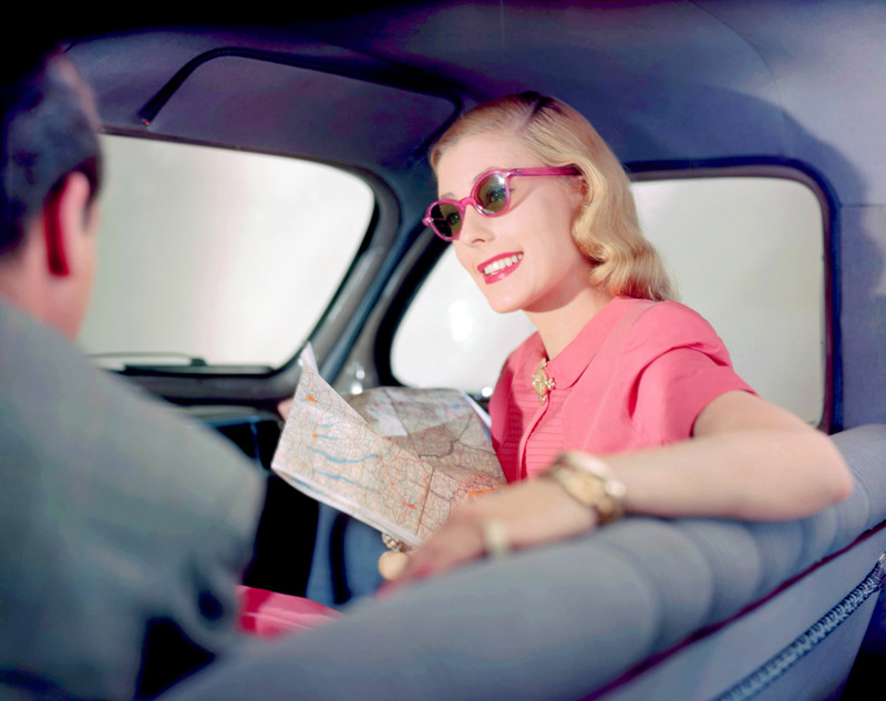 1956 --- Barbara Tollgren Modeling in a Car --- Image by © Genevieve Naylor/Corbis