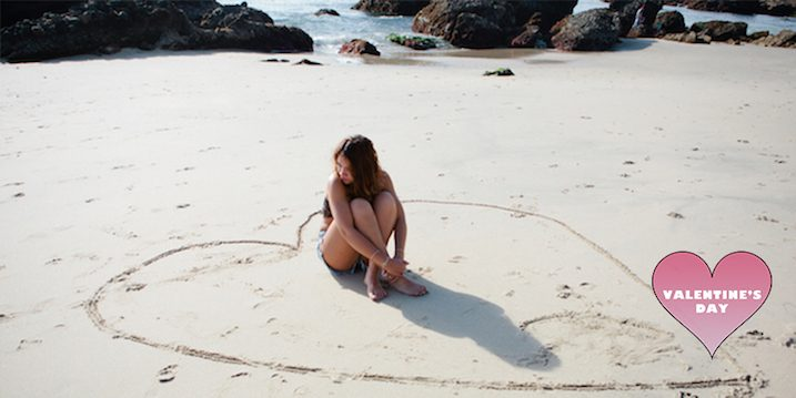 woman-beach-heart-sand