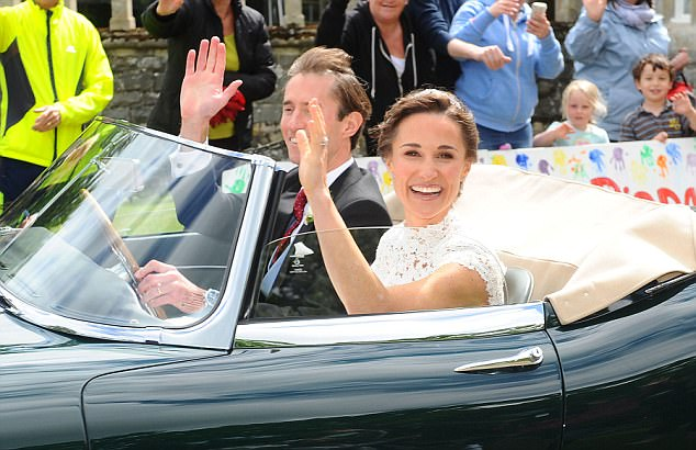 PICTURE KERRY DAVIES/DAILY MAIL 20/5/2017 Picture shows:Beaming Pippa Middleton and James Berkshire drive an E type Jaguar away from the church after their wedding on Saturday. Guests including the Duke and Duchess of Cambridge attended the wedding of Pippa Middleton and James Matthews. Miss Middleton, 33, who is the younger sister of the Duchess, married 41-year-old Mr Matthews at St Mark's Church in Englefield, Berkshire. The bride was accompanied by her father, Michael, as they arrived shortly after 11:15 BST for the 45-minute The church is a few miles from the Middleton family home in Bucklebury. There was strict security in place on the estate.